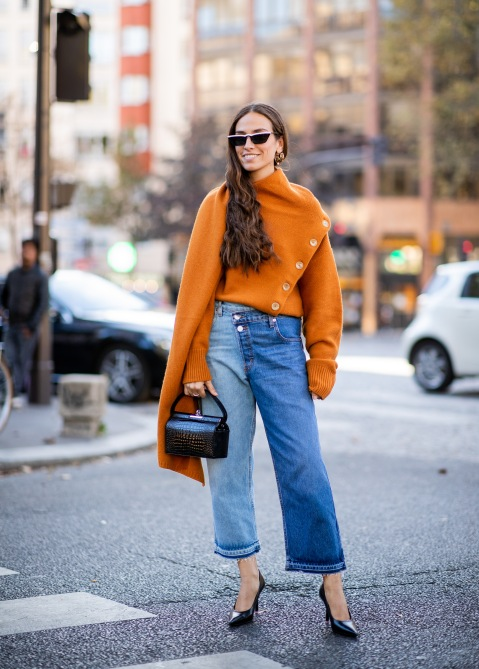 gettyimages 1040396636 3 Ways to Wear Fashion Month's Favorite Orange Sweater
