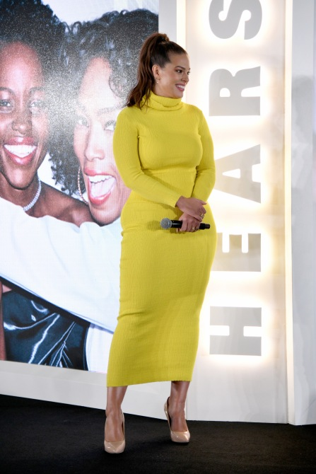 gettyimages 1052375426 Ashley Graham's Lime Green Pants Are the Statement Staple We Didn't Know We Needed