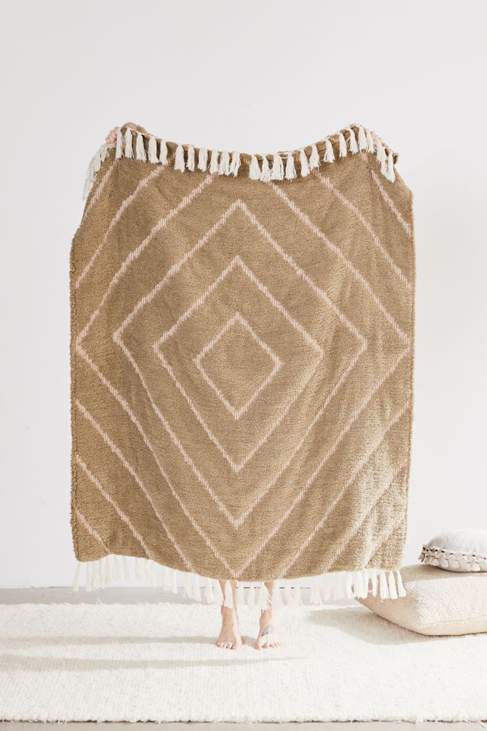 STYLECASTER | geometric throw blanket | boho bedroom decor