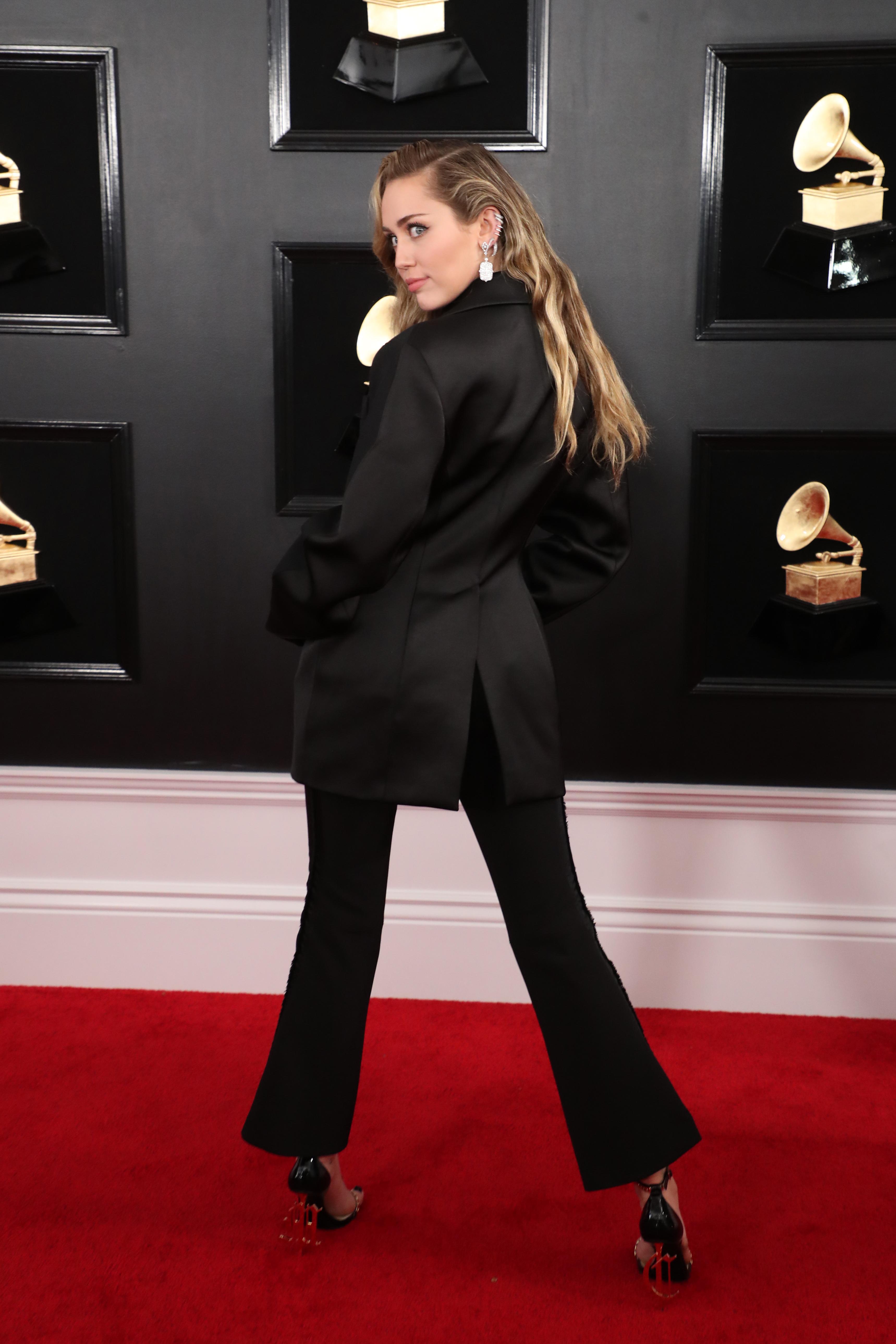 shutterstock 10095020ij Did Miley Cyrus Go Braless Under Her Grammys Power Suit?