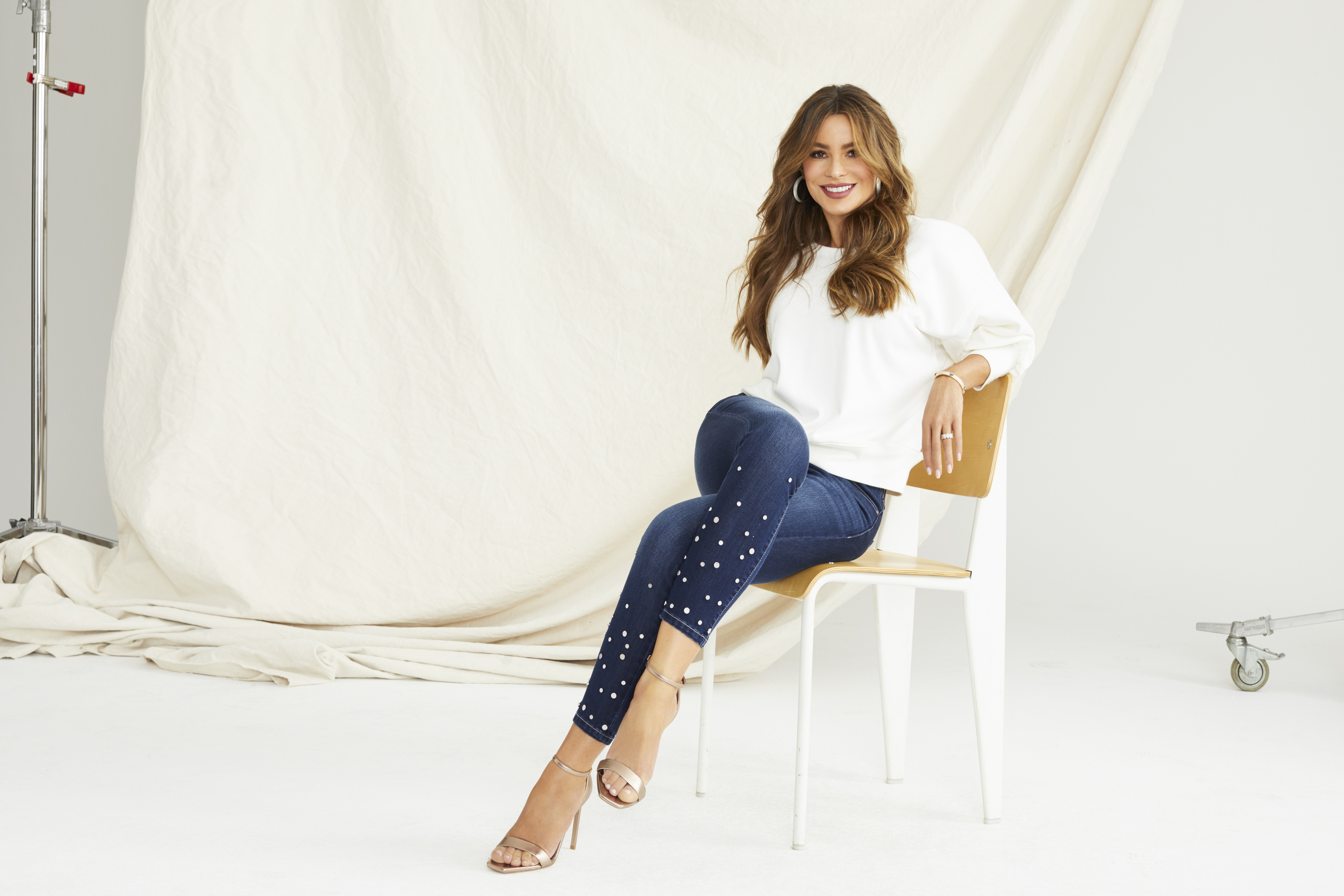 sofia vergara in the sofia skinny studded mid rise stretch ankle jean open back knit banded bottom Sofía Vergaras New Denim Line Is Everything You Love About Expensive Brands—at Walmart.com Prices