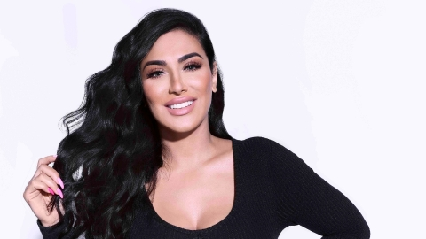 EXCLUSIVE: Huda Kattan's New Office Is Stuffed With Every Makeup Product Imaginable | StyleCaster