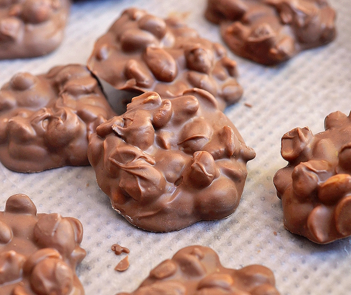 STYLECASTER | 17 Stoner Snacks You Can Actually Whip Up in the Slow-Cooker | Chocolate Peanut Clusters