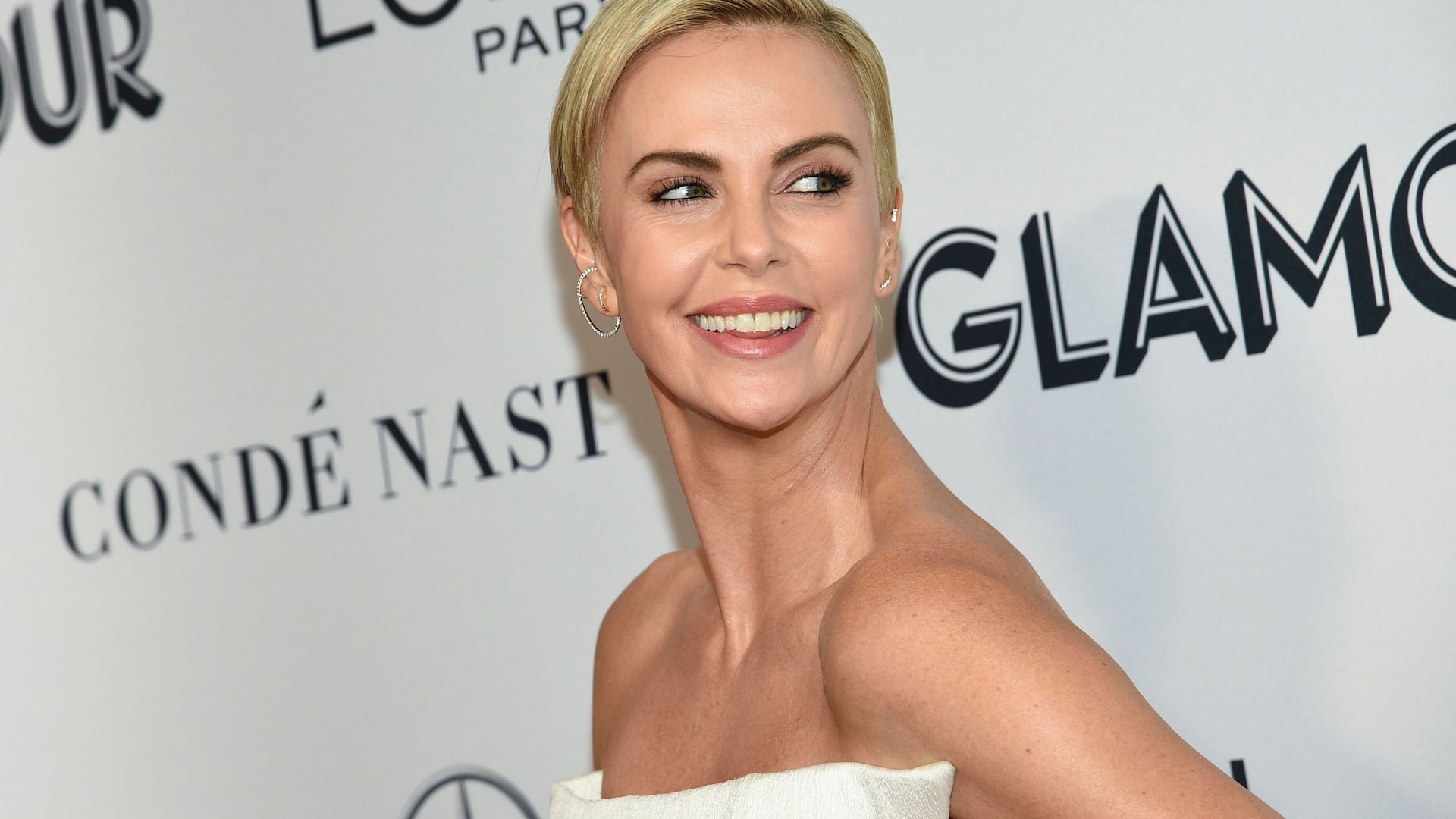 OMG—Charlize Theron Just Gave Us the Ultimate Winter Wedding Dress Inspo