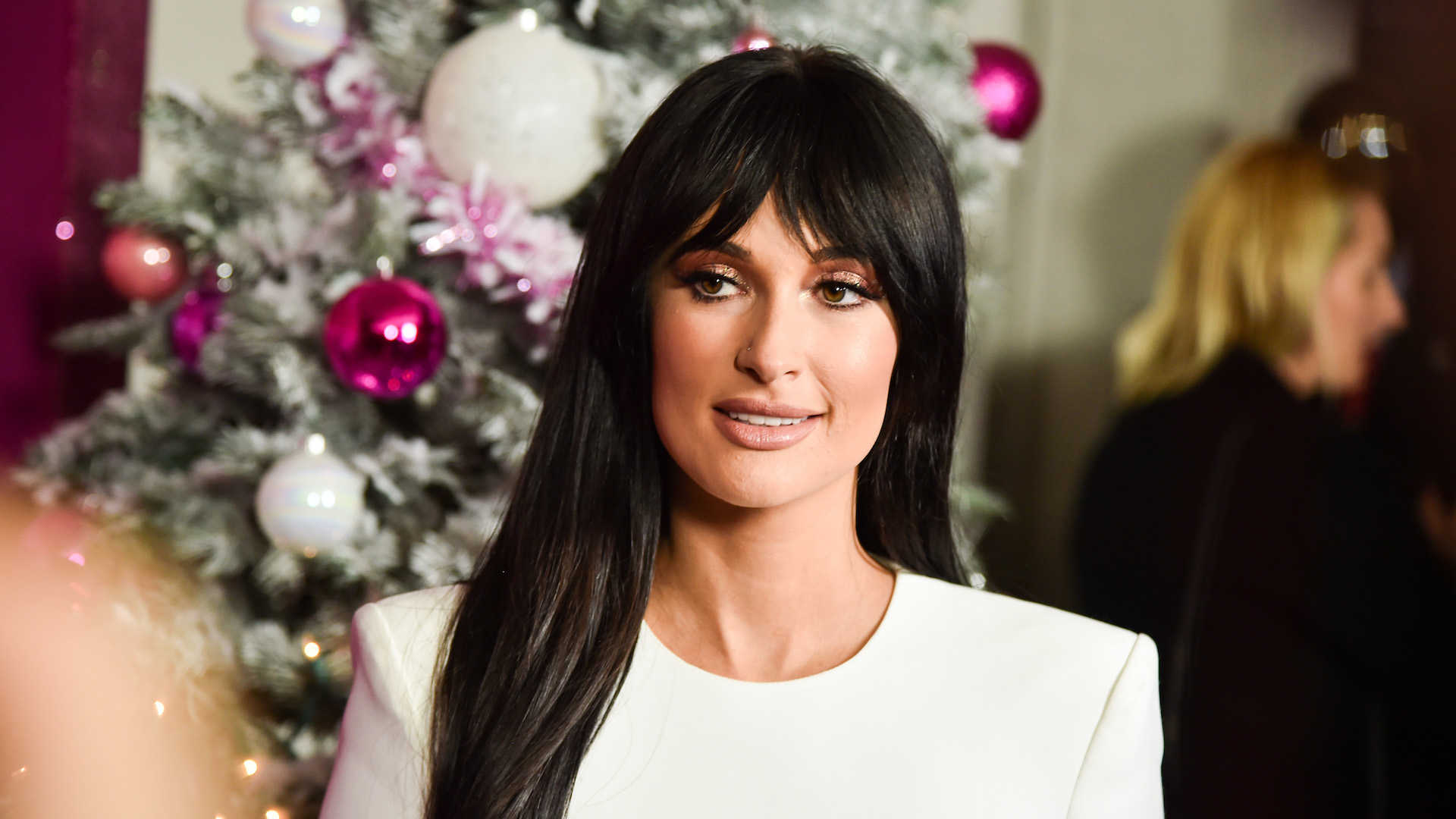 Kacey Musgraves' All-White Crop Top & Miniskirt Look Is Somehow Perfect for the Holidays