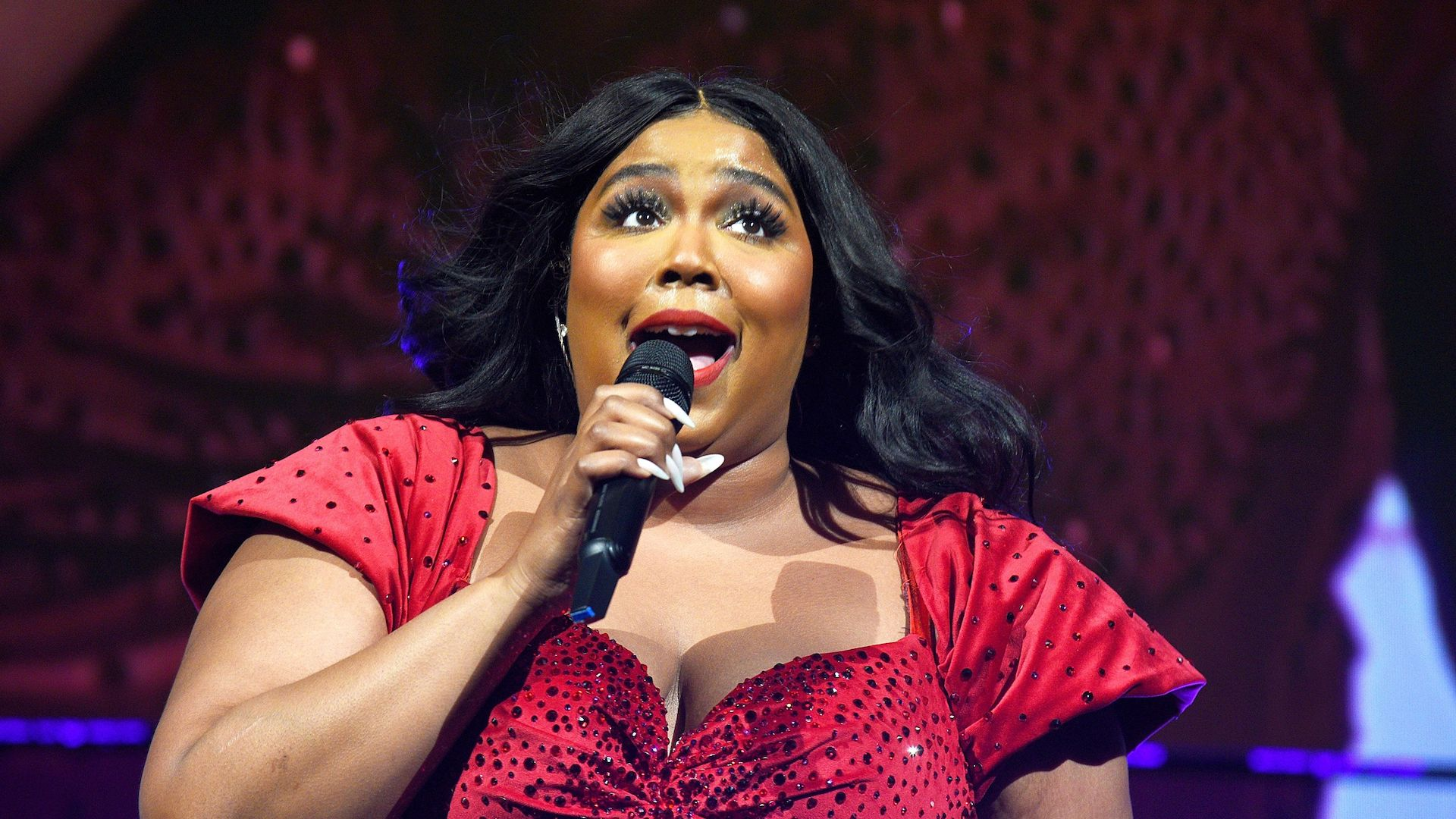Happy Holidays to Lizzo in This Sparkly Red Bodysuit and No One Else