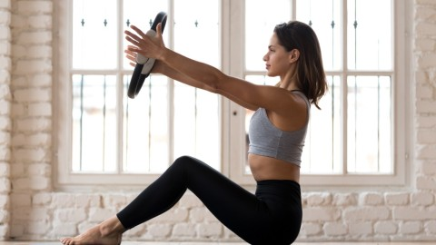 These Durable Resistance Rings For Pilates Can Elevate Your Practice Tenfold | StyleCaster