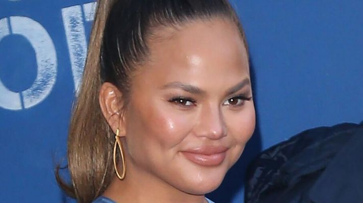 Chrissy Teigen Really, Really Wants Her Breast Implants Out