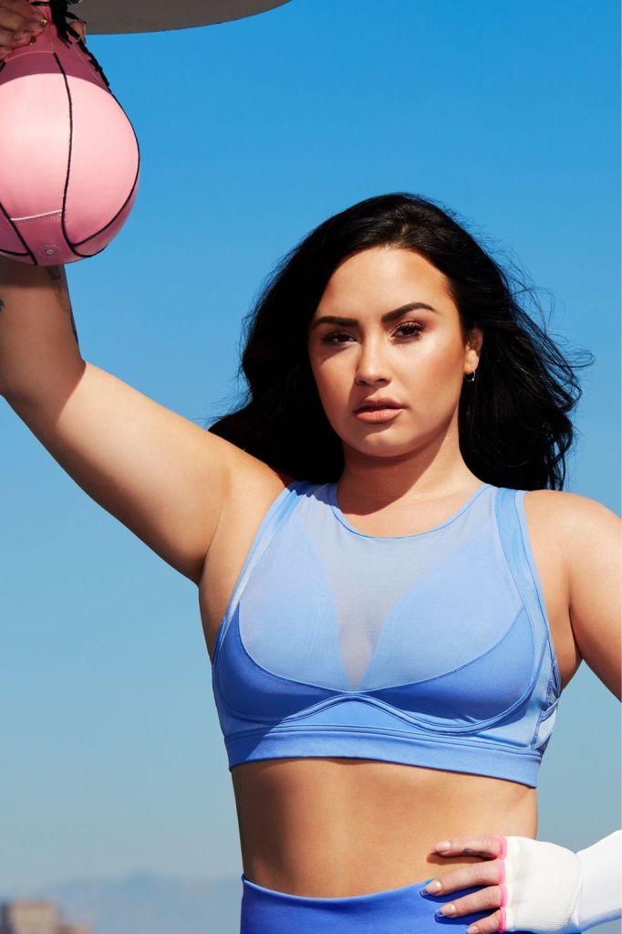 STYLECASTER | Demi Lovato x Fabletics | blue sports bra