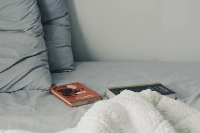 STYLECASTER   Zodiac Signs Zoom Background   books on bed
