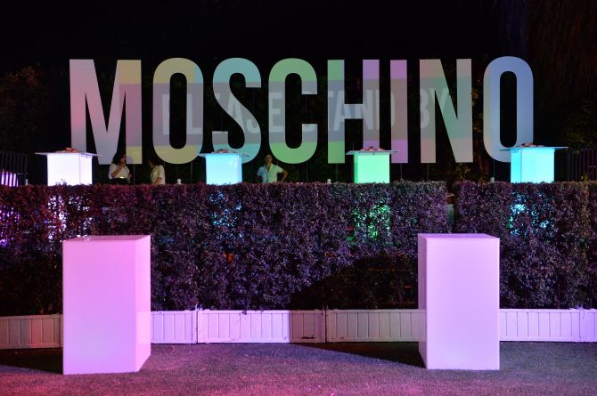 coachella moschino sign 13 Festival Zoom Backgrounds That Are *Almost* As Good As the Real Thing
