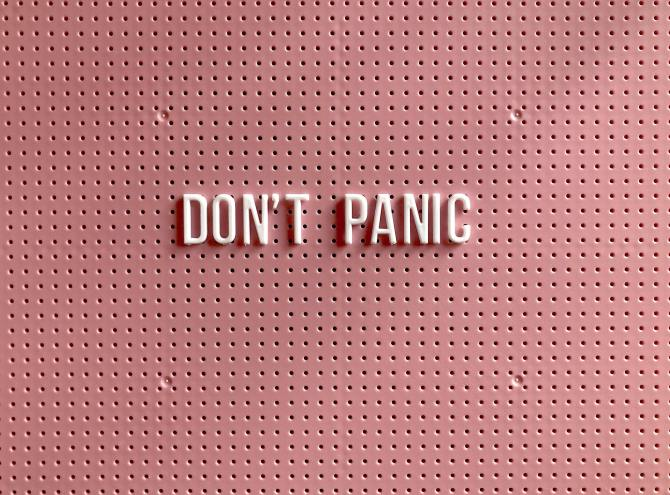STYLECASTER | Staying Calm During a Pandemic | Don't Panic Sign