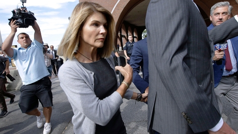 Lori Loughlin Hid Behind a Trash Bag After She Was Released From Prison Early | StyleCaster